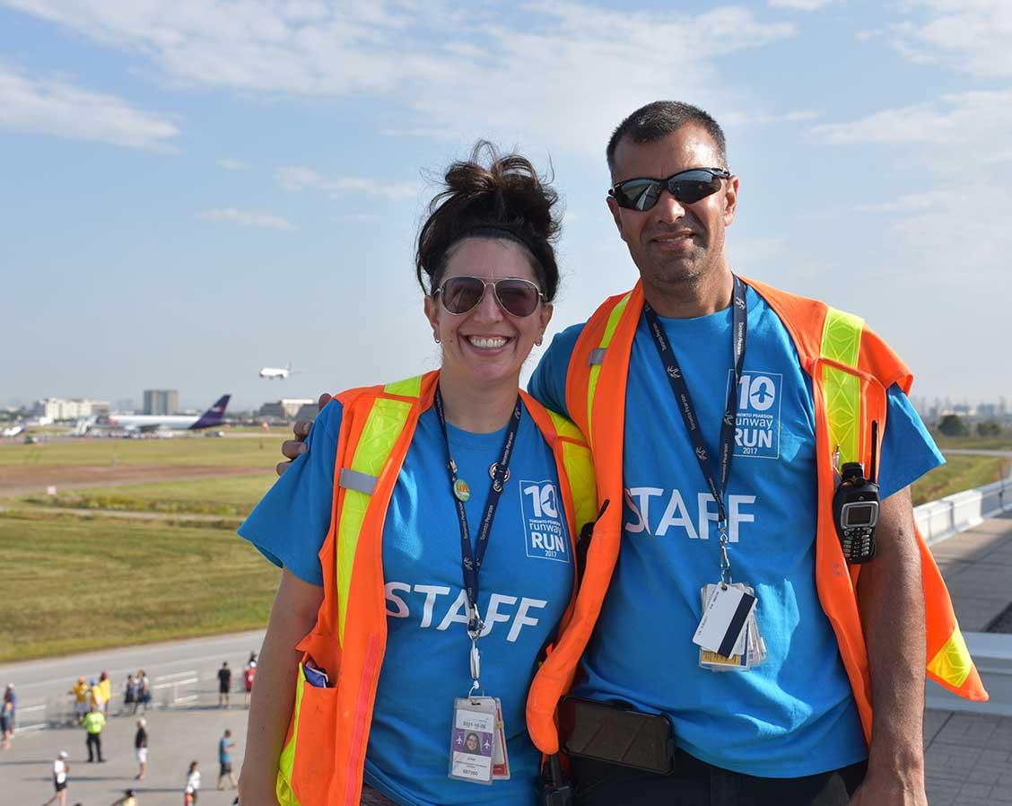 Two staff members at the Runway Run