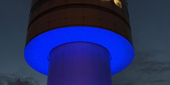 Apron tower lit up blue