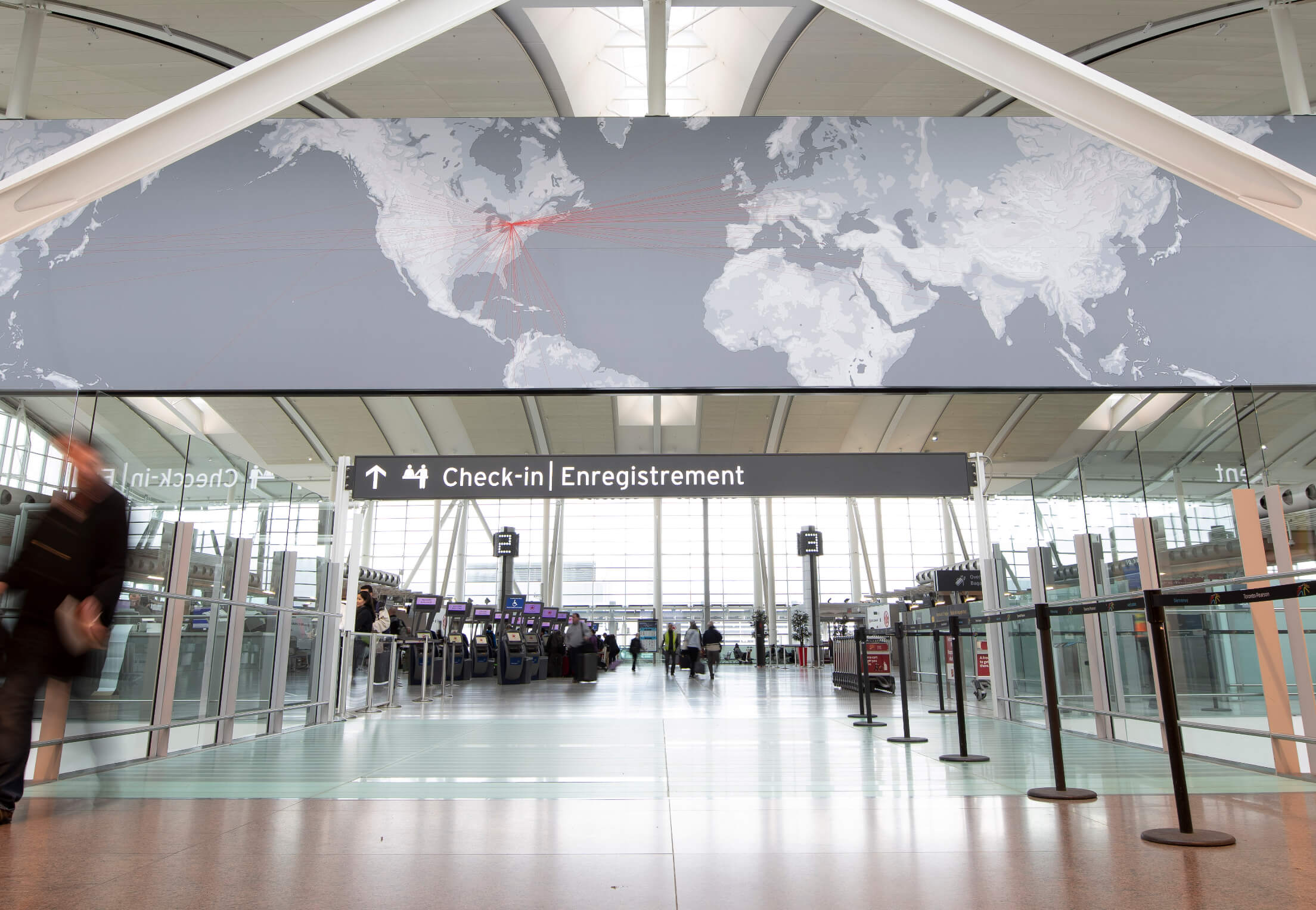 The inside of Toronto Pearson Airport, at the check-in area