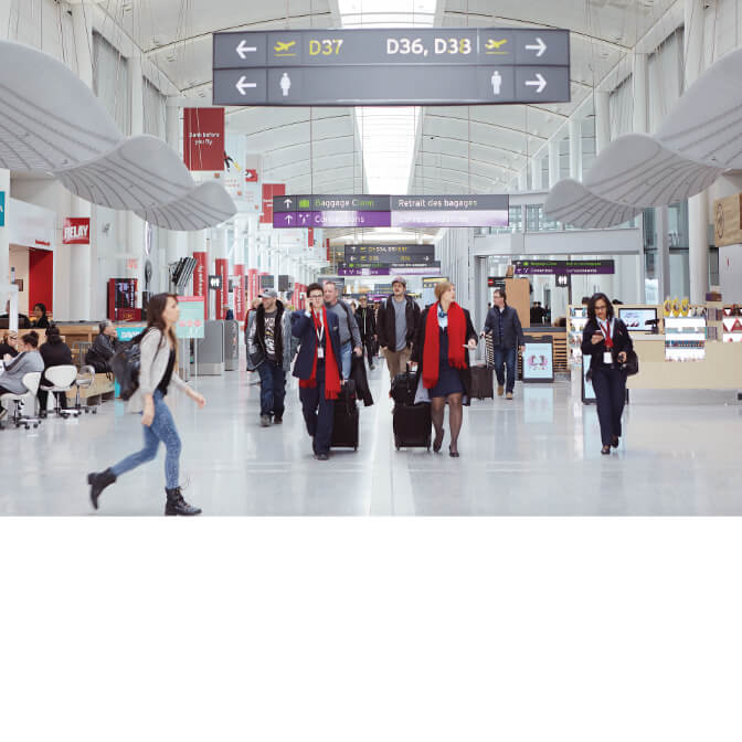 Travellers inside Toronto Pearson Airport