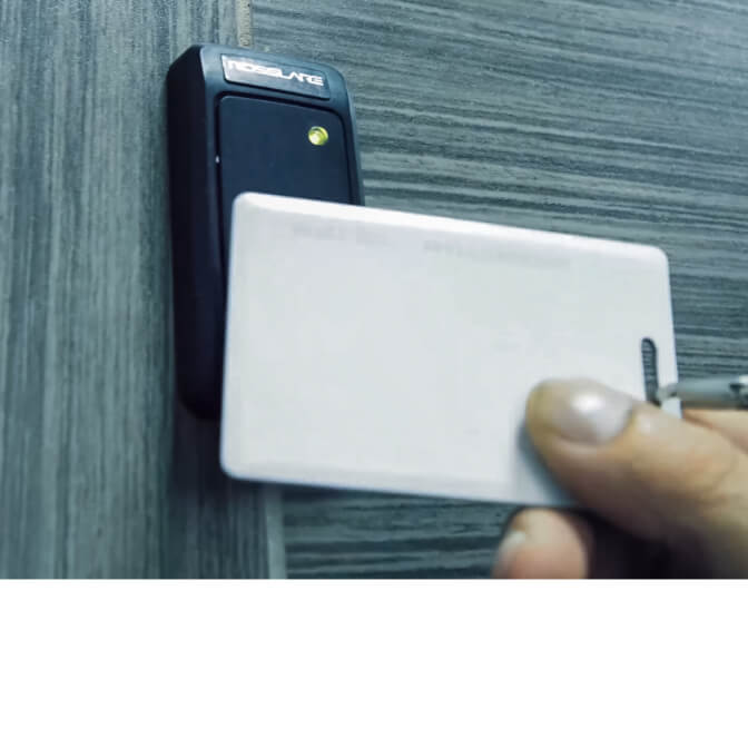 An RFID access card held against a security scanner