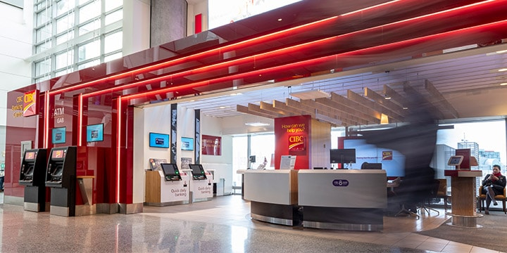 CIBC Banking Centre with service counter and ATMs in Pearson terminal.